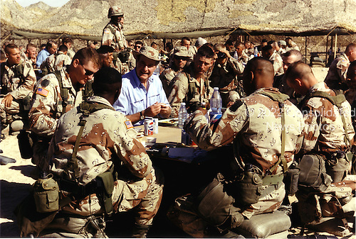 Saudi Arabia - November 22, 1990 -- United States President George H.W. Bush shares the holiday meal with United States military personnel in Saudi Arabia on Thanksgiving Day, November 22, 1990..Credit: David Valdez - WH via CNP