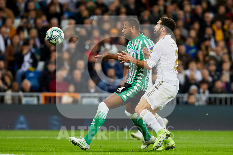 Dani Carvajal of Real Madrid and Emerson Aparecido of Real Betis Balompie during La Liga match between Real Madrid and Real Betis Balompie at Santiago Bernabeu Stadium in Madrid, Spain. November 02, 2019. (ALTERPHOTOS/A. Perez Meca)