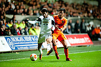 Thursday 28 November  2013  Pictured: Alejandro Pozuelo in a challenge with Dani Parejo of Valencia<br /> Re:UEFA Europa League, Swansea City FC vs Valencia CF  at the Liberty Staduim Swansea