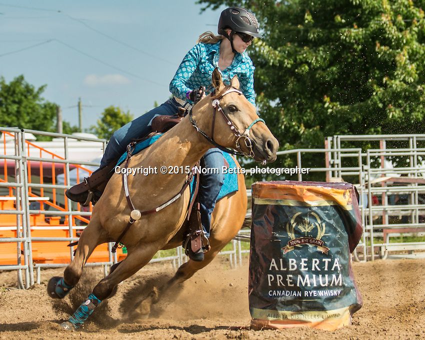 Ontario's Ultimate Rodeo Tour,  July 10th at the Calhoun Stables, east of Kitichener, Ontario, Canada<br /> <br /> &copy;2015, Norm Betts, photographer <br /> 416 460 8743<br /> normbetts@canadianphotographer.com