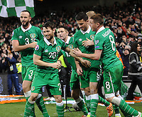 29th March 2015; UEFA EURO 2016 Championship Qualifier Group D, Ireland vs Poland, Aviva Stadium, Dublin<br /> Republic of Ireland players celebrate with Shane Long after he scored his side's equalising goal.<br /> Picture credit: Tommy Grealy/actionshots.ie.