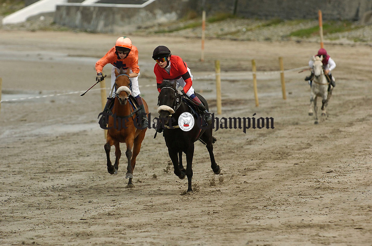 Maniac, right,  and Tail To Tail battle it out in an early race during the Strand races in Kilkee. Photograph by John Kelly.