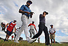 Rafa Cabrera Bello, front left (blue shirt), strides to the 18th Hole alongside Sergio Garcia as fellow Spaniard Jon Rahm, orange and white shirt, walks behind them during the first round of the U.S. Open Championship at Shinnecock Hills Golf Club in Southampton on Thursday, June 14, 2018.