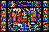 The immersion baptism of Saint Louis, held by his mother Blanche of Castile and blessed by the bishop, stained glass window, 1871, in the apse of the Collegiale Notre-Dame de Poissy, a catholic parish church founded c. 1016 by Robert the Pious and rebuilt 1130-60 in late Romanesque and early Gothic styles, in Poissy, Yvelines, France. The windows of the apse tell the story of Saint Louis or King Louis IX of France, born in Poissy in 1214. The Collegiate Church of Our Lady of Poissy was listed as a Historic Monument in 1840. Picture by Manuel Cohen