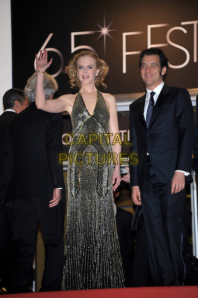 Nicole Kidman, Clive Owen.'Hemingway & Gellhorn' screening at the 65th  Cannes Film Festival, France,.24th May 2012..full length gold beaded halternck long maxi dress  black navy blue black tuxedo tux suit bow tie hand waving .CAP/PL.©Phil Loftus/Capital Pictures.