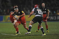 Jamie George of Saracens looks for space past Dom Barrow of Leicester Tigers during the Premiership Rugby match between Saracens and Leicester Tigers - 02/01/2016 - Allianz Park, London<br /> Mandatory Credit: Rob Munro/Stewart Communications