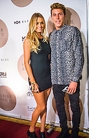 North Shore, Oahu, Hawaii (Friday, December 6, 2013) Alana Blanchard (HAW) and boyfriend Jack Freestone (AUS)&ndash; The 44th Annual Surfer Poll Awards  were held tonight at the Turtle Bay Resort on the North Shore of O&rsquo;ahu. The ceremony brought together the best surfers, filmmakers, and surf legends all under one roof to honor the best films and performances of the year.<br /> <br /> Each year the SURFER staff pores through all of the full-length films and web shorts produced that year, narrowing down hundreds of great rides and notable moments to just a handful of nominees. And while it&rsquo;s always a challenge, this year there was one surfer/co-director who dominated the movie categories: John John Florence (HAW). Not only was he voted second in the reader poll, he also took home Best Performance for his surfing in Done, Best Short for his film Begin Again and Movie of the Year for Done, both of which he co-directed with Blake Kueny (USA).<br /> <br /> For the Men&rsquo;s reader poll, it came as no surprise that once again Kelly Slater (USA) who took the No. 1 slot, making this his 19th Surfer Poll win since he first topped the list in 1993. On the women&rsquo;s side of the poll, it was Alana Blanchard (HAW) who was voted into the top slot over current World Champion Carissa Moore  (HAW) (Women&rsquo;s No. 3) and five-time World Champion Steph Gilmore (AUS) (Women&rsquo;s No 5). This is her first time winning the Women&rsquo;s No. 1 award, up from No. 2 in 2012.  Photo: joliphotos.com