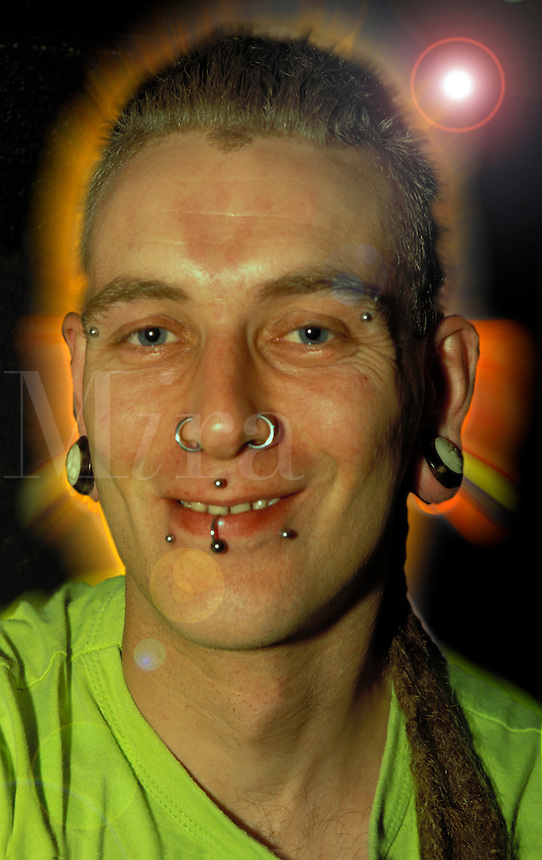 Young man with facial piercing