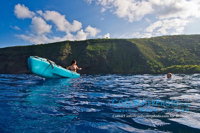 Women enjoying kayaking and swimming, Kealakekua Bay, Big Island, Hawaii, Pacific Ocean.