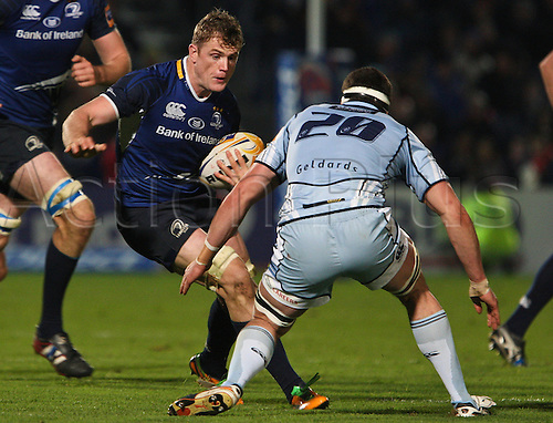 27.10.2012 Dublin, Ireland. Jamie Heaslip in action against Robin Copeland, during the RaboDirect PRO12 game between Leinster and Cardiff Blues from the Royal Dublin Society.