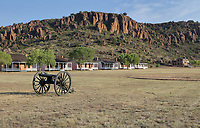 Cannon on the parade ground and behind, the Officers' Row, living quarters for the army officers, at Fort Davis National Historic Site, a US army fort established 1854, in a canyon in the Davis Mountains in West Texas, USA. The fort was built to protect emigrants, mail coaches, and freight wagons on the trails through the State from Comanche and Apache Indians. After the Civil War, several African-American regiments were stationed here. By the 1880s, the fort consisted of one 100 buildings, housing over 400 soldiers. It was abandoned in 1891, but many buildings have been restored and the compound now operates as a historical site and museum. Picture by Manuel Cohen