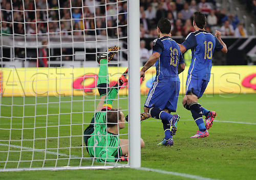 03.09.2014. Esprit Arena, Düsseldorf, Germany. International football friendly match. Manuel Neuer (Ger) is beaten from close range for the first goal by Sergio Aguero (Arg)  Erik Lamela seen in the back cheering