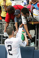 Heath Pearce signs a jersey for fans. USA defeated Grenada 4-0 during the First Round of the 2009 CONCACAF Gold Cup at Qwest Field in Seattle, Washington on July 4, 2009.
