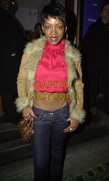 CAROLINE CHIKEZIE.leaving celebrity party at Harvey Nichols.10 February 2004.red crop top, fur collar jacket, belly button, midriff, stomach.www.capitalpictures.com.sales@capitalpictures.com.©Capital Pictures.
