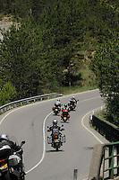 Motorbikes on curving road. Aragon, Spain.