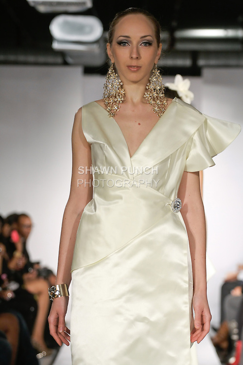 "Model walks runway in an Bridal outfit from the Jewel Shannon ""Island Pearl"" collection, during BK Fashion Weekend Fall Winter 2012."