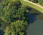Aerial view of Althorp House and the oval lake and island where Princess Diana of Wales is buried. Great Brington, Northamptonshire England 2007. Detail showing earth works.