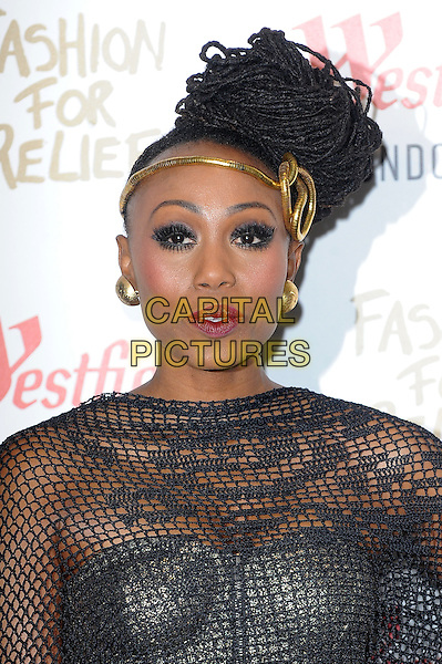 LONDON, ENGLAND - NOVEMBER 27: Folami Ankoanda-Thompson attends the Fashion For Relief Pop Up Launch Party at Westfield Shopping Centre on November 27, 2014 in London, England.<br />  CAP/BEL<br /> &copy;Tom Belcher/Capital Pictures