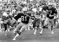 Raiders vs Kansas City, Dave Casper #87 and Raider #81 Morris Bradshaw.<br />(photo/Ron Riesterer)