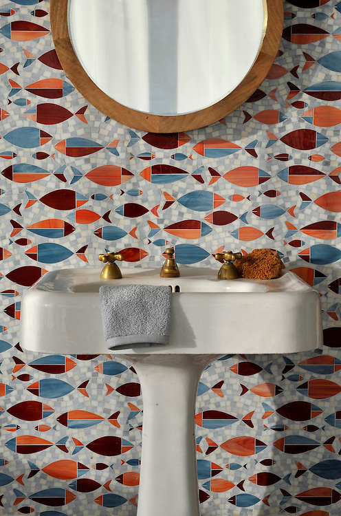 Floating Fish, a waterjet glass mosaic shown in Mica, Sardonyx, Garnet, Pearl, and Quartz, is part of the Erin Adams Collection for New Ravenna.