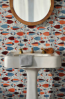 Floating Fish, a waterjet glass mosaic shown in Mica, Sardonyx, Garnet, Pearl, and Quartz, is part of the Erin Adams Collection for New Ravenna Mosaics.<br />