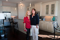 Southwest Florida Photographer Debi Pittman Wilkey and Debbie Babbs, Project Manager FrontDoor Communities, selected artwork by Debi Pittman Wilkey for display at a Andalucia model home in Naples ...  http://www.andalucianaples.com/ ... Photo/Gary Jung