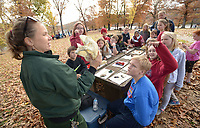 NWA Democrat-Gazette/ANDY SHUPE<br /> Laurel Poff, a forestry technician for the U.S. Forestry Service, shows an alligator snapping turtle skull Wednesday, Nov. 7, 2018, to students in Kevin Geng's fifth-grade science class at Lincoln Middle School during Forest Appreciation Day sponsored by the Arkansas Forestry Association Education Foundation at Lake Wedington in Washington County.