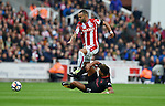 Jese of Stoke City is challenged by Alex Oxlade-Chamberlain of Arsenal during the premier league match at the Britannia Stadium, Stoke. Picture date 19th August 2017. Picture credit should read: Robin Parker/Sportimage