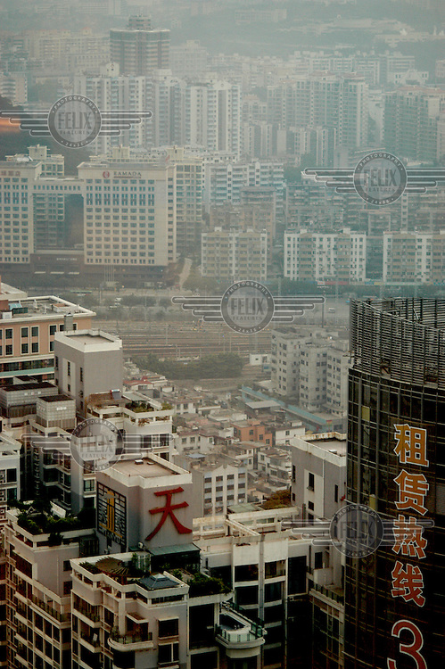 The skyline of Guangzhou, clouded by pollution, as seen from the CITIC Plaza Building.
