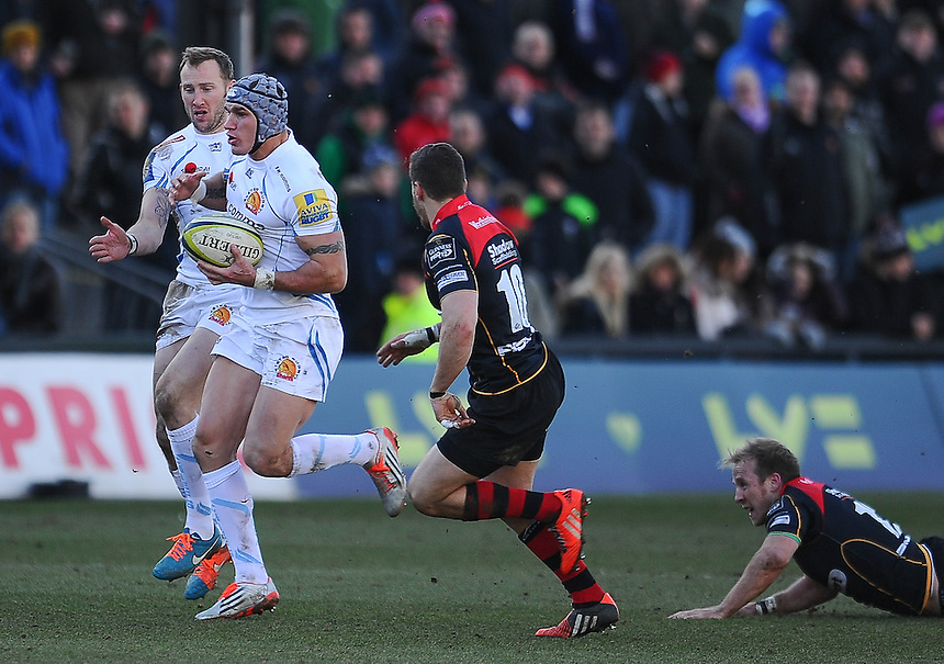 Exeter Chiefs' Tom James evades the tackle of Newport Gwent Dragons' Dorian Jones<br /> <br /> Photographer Craig Thomas/CameraSport<br /> <br /> Rugby Union - European Rugby Challenge Cup Pool 3 - Newport Gwent Dragons v Exeter Chiefs - Sunday 1st February  2015 - Rodney Parade - Newport <br /> <br /> &copy; CameraSport - 43 Linden Ave. Countesthorpe. Leicester. England. LE8 5PG - Tel: +44 (0) 116 277 4147 - admin@camerasport.com - www.camerasport.com