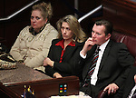 Sen. Ben Kieckhefer, his wife April and a guest listen as Governor Brian Sandoval talks to state lawmakers during Monday's State of the State address, Jan. 24, 2011, at the Legislature in Carson City, Nev. .Photo by Cathleen Allison