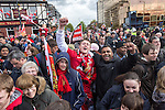 © Joel Goodman - 07973 332324 . 13/05/2013 . Manchester , UK . Fans lined Chester Road at the top of Sir Matt Busby Way . Manchester United trophy parade on Sir Matt Busby Way , from Old Trafford to Manchester City Centre this evening (Monday 13th May) . The team are celebrating their 20th league title win and commemorating the retirement of manager , Sir Alex Ferguson , by carrying the trophy on an opened top bus through the city . Photo credit : Joel Goodman