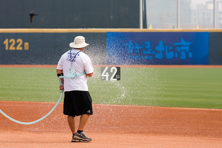 18 August 2007: Sports Turf Superintendent Budgie Clark sprinkles the infield prior to the China 5-1 victory over France in the Good Luck Beijing International baseball tournament (olympic test event) at the Wukesong Baseball Field in Beijing, China.