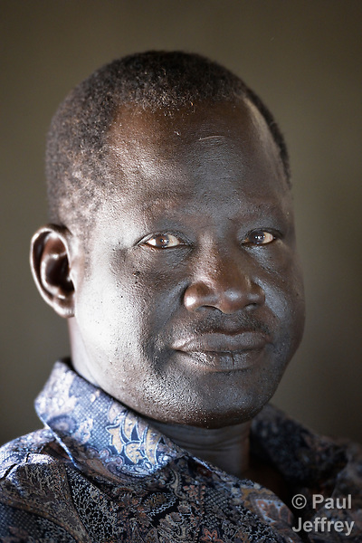 Kuol Deng Kuol, the paramount chief of the Dinka Ngok, in his office in Abyei, a town at the center of the contested Abyei region along the border between Sudan and South Sudan. Homes here were looted and burned in 2011 when soldiers and militias from the northern Republic of Sudan swept through the area, chasing out more than 100,000 Dinka Ngok residents. The chief and a few thousand other families returned once northern combatants withdrew in 2012. On May 4, 2013, the chief was killed when his vehicle, part of a United Nations convoy, was fired upon by Khartoum-backed Misseriya militia.