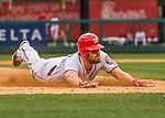 7 April 2016: Washington Nationals infielder Daniel Murphy dives safely into third with a 3-RBI, bases-loaded triple, in the first inning of the Nationals' Home Opening Game against the Miami Marlins at Nationals Park in Washington, DC. The Marlins defeated the Nationals 6-4 in their first meeting of the 2016 MLB season. Mandatory Credit: Ed Wolfstein Photo *** RAW (NEF) Image File Available ***