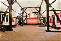 BNPS.co.uk (01202 558833)<br /> Pic: CarterJonas/BNPS<br /> <br /> ***Please Use Full Byline***<br /> <br /> The stage, in the theatre at Little Easton manor. <br /> <br /> <br /> One of Britain's most historic country houses which boasts a theatre that has played host to Charlie Chaplin and H.G. Wells has gone on the market with a &pound;5 million price tag.<br /> <br /> In the early 1900s the sprawling estate's tithe barn was transformed into a theatre in which the great and the good of the acting world flocked to perform.<br /> <br /> Edwardian actress Ellen Terry gave poetry readings there while War of the Worlds author H.G. Wells, who lived with his family in a house on the estate, also frequented the theatre.<br /> <br /> Other regular performers included Charlie Chaplin, Gracie Fields and George Formby.<br /> <br /> In more recent years it has welcomed famous faces such as Rowan Atkinson, Bill Cotton, Tim Rice, Esther Rantzen and even the cast of Eastenders.<br /> <br /> The 17th century Grade II listed manor is on the market with Carter Jonas estate agents for &pound;5 million.