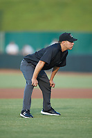 Umpire Rene Gallegos handles the calls on the bases during the South Atlantic League game between the Charleston RiverDogs and the Hickory Crawdads at L.P. Frans Stadium on August 10, 2019 in Hickory, North Carolina. The RiverDogs defeated the Crawdads 10-9. (Brian Westerholt/Four Seam Images)