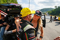 Jun 18, 2017; Bristol, TN, USA; NHRA top fuel driver Leah Pritchett (right) congratulates race winner Clay Millican as he celebrates after winning the Thunder Valley Nationals at Bristol Dragway. Mandatory Credit: Mark J. Rebilas-USA TODAY Sports