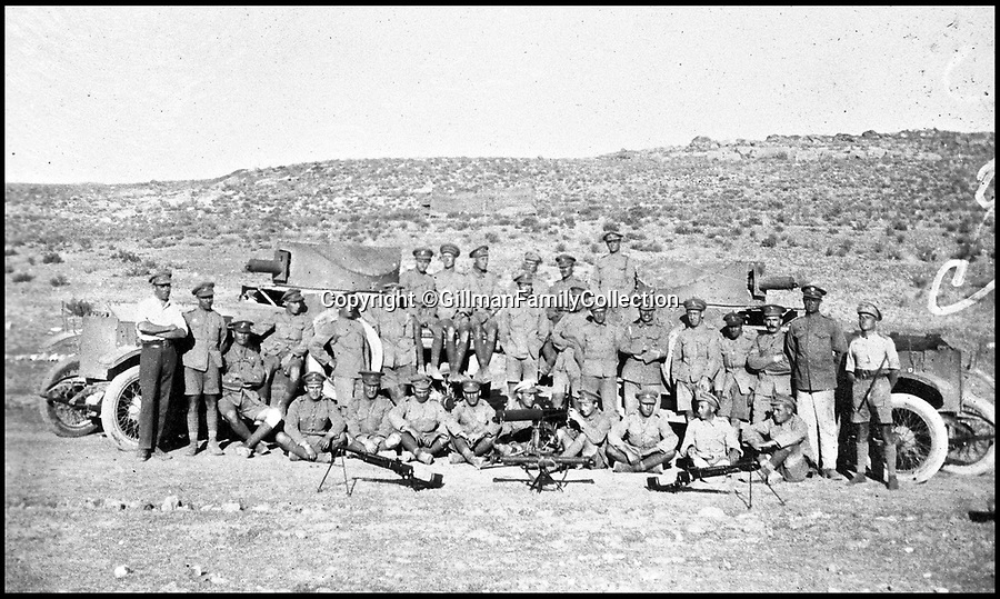Bournemouth News (01202 558833)<br /> Pic: GilmanFamilyCollection/BNPS<br /> <br /> The British troops of the Hejaz Armoured Car Battery in the desert. <br /> <br /> Fascinating never before seen photos of the Arab Revolt have revealed Lawrence of Arabia actually had help from a plucky band of British troops as well as the Arab tribesmen.<br /> <br /> A new book reveals the legendary campaign, that did much to shape the modern map of the Middle East, used cutting edge weapons like Rolls Royce armoured car's and British crewed aircraft to attack the Turkish enemy alongside the native arab army.<br /> <br /> The photos feature in military historian James Stejskal's new book Masters of Mayhem which sheds new light on T.E Lawrence's achievements fighting alongside Arab guerrilla forces in the Middle East during the First World War.<br /> <br /> They had been tucked away in the private photo albums of the descendants of soldiers who fought alongside Lawrence during the campaign.<br /> <br /> One historically important photo shows Lawrence and his driver sitting in a Rolls Royce in Marjeh Square in Damascus after it was captured in October 1918.<br /> <br /> Another documents the dramatic moment a water tower and windmill pump are blown up in the desert.
