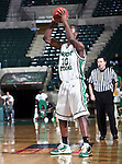 North Texas Mean Green forward Jacob Holmen (30) looks for an open player  in the game between the Texas State Bobcats and the University of North Texas Mean Green at the North Texas Coliseum,the Super Pit, in Denton, Texas. UNT defeated Texas State 85 to 62
