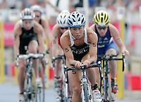30 JUL 2006 - SALFORD, UK - Andrea Hewitt (NZL) leads a pack at the Salford ITU World Cup triathlon round. (PHOTO (C) NIGEL FARROW)