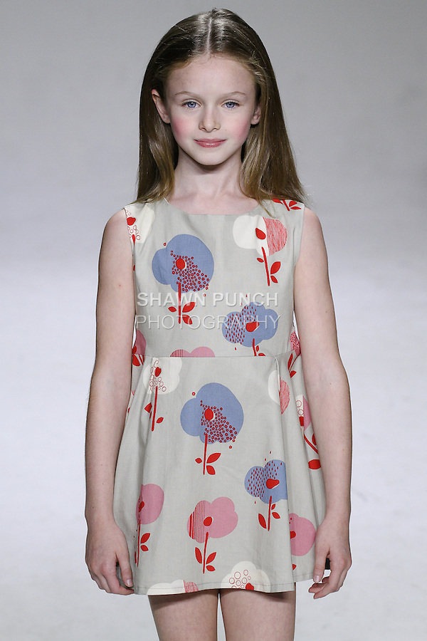 Young model walks runway in an outfit from the Aria Children's Clothing 2015 collection by Peini Yang, at petitePARADE Spring Summer 2015, during Kids Fashion Week in New York City, on October 19, 2014.