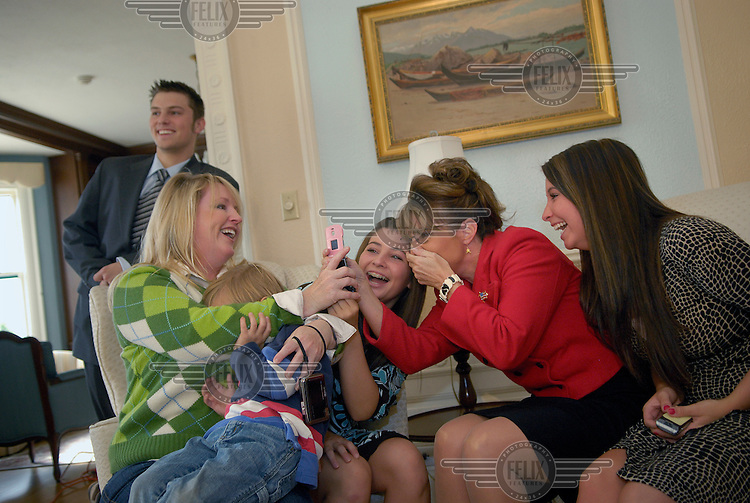 Sarah Palin, Governor of Alaska, shares a joke with her family at the Governor's Mansion in Juneau. In 2008 she was nominated as the Republican candidate for Vice President. From left to right: Track Palin, Molly - Sarah Palin's sister - and her son Heath, Willow Palin, Sarah and Bristol Palin..