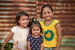 Three indigenous girls in the Nacoes Indigenas neighborhood in Manaus, Brazil. The neighborhood is home to members of more than a dozen indigenous groups, many of whose members have migrated to the city in recent years from their homes in the Amazon forest.