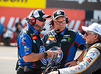 Sep 2, 2018; Clermont, IN, USA; Crew members for NHRA funny car driver Robert Hight talk with John Force during qualifying for the US Nationals at Lucas Oil Raceway. Mandatory Credit: Mark J. Rebilas-USA TODAY Sports