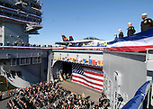 Norfolk, VA - January 10, 2009 -- Sailors assigned to the aircraft carrier USS George H.W. Bush (CVN 77) man the rails during the ship?s commissioning ceremony at Naval Station Norfolk, Virginia.  The Navy's newest, and final, Nimitz-class aircraft carrier is named after World War II naval aviator and the 41st president of the United States George H.W. Bush. .Credit: Susan Caraballo - U.S. Navy via CNP
