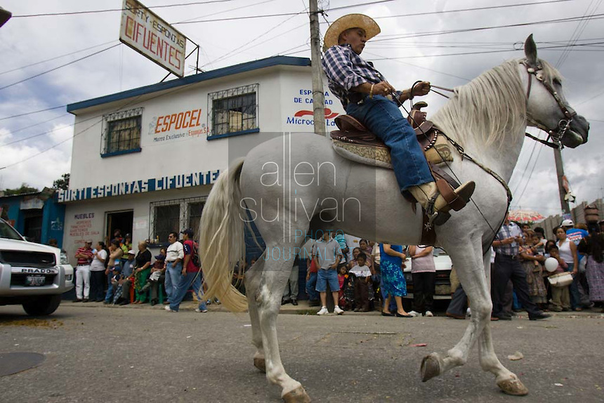 A parade of caballeros in the western Guatemala highlands.