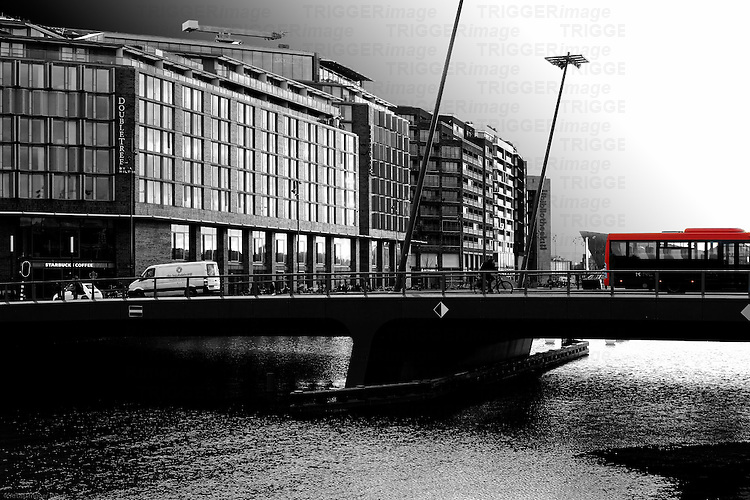 Traffic crosses the Odebrug Bridge before the Doubletree by Hilton Hotel in Amsterdam.