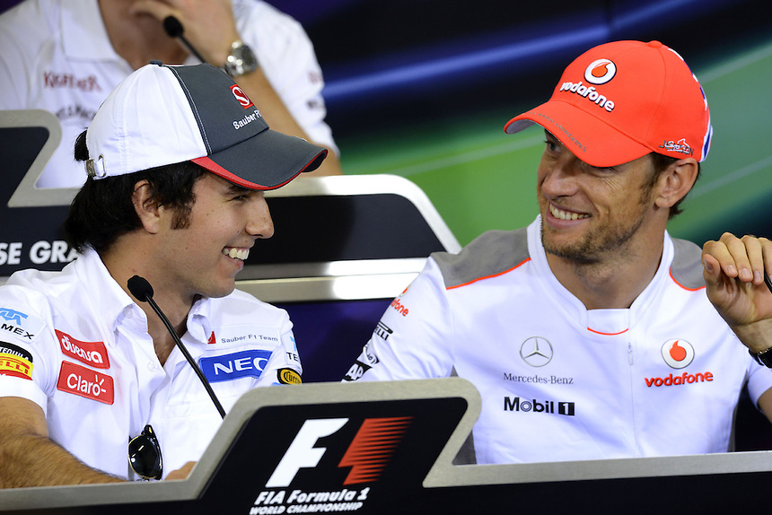 .Sergio Perez (MEX) Sauber F1 Team - Jenson Button (GBR),  McLaren F1 Team..2012 FIA Formula One World Championship - Japanese Grand Prix - Suzuka Circuit - Suzuka - Japan - Thursday 4th October 2012...