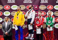 Jordan Burroughs of the United States (cq, in blue), during the national anthem after winning gold at the Pan American Championships at Dr. Pepper Arena in Frisco, Texas, Saturday, February 27, 2015. Burroughs career record is 122-2 after the event.<br /> <br /> Photo by Matt Nager
